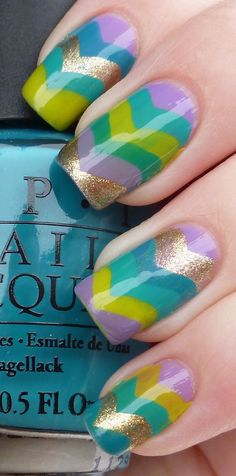I don't like the zig zag but I like her colors.  The colours she used were OPI Do You Lilac It?, Fly, Did It On 'Em, China Glaze Four Leaf Clover, and Quo by ORLY Filthy Rich.