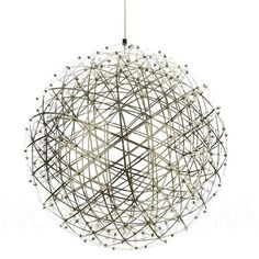 #Dutch mathematics professor #RaimondPuts created the #RaimondLED suspension #light in #2007. He brought his love of #geometry and precision into the #design of the globe. The triangular #geometric structure is made from polished stainless steel that conducts electricity. An LED light has been placed at each intersection of the structure, with the largest version having 252 LEDs. When seen against a dark background, the light appears made of hundreds of tiny #stars, giving you your very o...