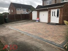 Here is another completed driveway installation by SD Home Improvements LTD. Your expert driveway installer near you in Bristol. Dug out and removed the old concrete driveway and extended the new driveway into the gravel lawn area. Put in a new foundation, new drainage system for SUDS, membrane...