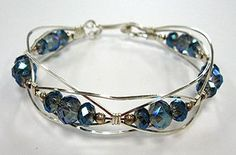 Wirewrap bangle.  Interesting undilating variation. - jewelry handmade, british jewellery shops, gold jewellery designs *sponsored https://www.pinterest.com/jewelry_yes/ https://www.pinterest.com/explore/jewellery/ https://www.pinterest.com/jewelry_yes/jade-jewelry/ https://www.saksfifthavenue.com/main/SectionPage.jsp?FOLDER%3C%3Efolder_id=2534374306418050