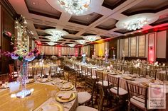 Circular and rectangular tables with gold chivari chairs at Indian reception via IndianWeddingSite.com