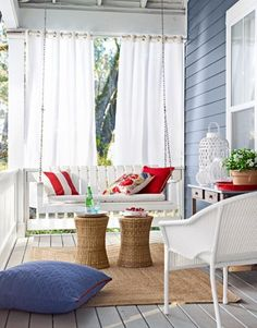 Light and airy and happy. And there is that house color again. My dream porch would have an outdoor rug like this. And how clever are those curtains? I'd use shower curtain liners that can take the rain…
