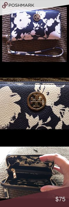 Tory Burch wallet/wristlet Navy with cream flowers. 3 card slots, pocket for phone, zippered coin compartment. Hardware shows a little bit of wear. Retails for $158. Tory Burch Bags Wallets