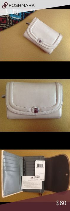 Coach Single Flap Wallet SV Shell This is a stunning wallet in great condition! Single flap w/ shell leather exterior & gray leather interior. 10 card slots, two open compartments & one zippered compartment inside. Open compartment on the outside. Silver hardware & button closure. // Exterior leather is somewhat worn & has some very light markings but still great condition. See photos. Coach Bags Wallets