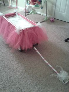 Flower Girl Wagon...use white or other wedding colors for the tulle skirt.