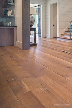 Wide Plank White Oak Hardwood Floor by Oak and Broad with Custom Stain | Rustic modern Tennessee living room with contrasting wood trim