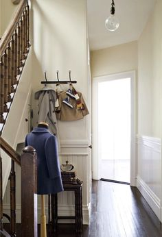 Decorating with White - Victorian Charm - lookslikewhite Blog - lookslikewhite/ love the dressmaker's dummy used as a coat rack!