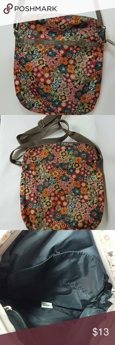 """Lesportsac Small Floral Crossbody Pretty little flowers on this tan Lesportsac crossbody tote.  10"""" x 8? x 1.5"""", compact in size, but hold a lot.  Top zip closure.  Front pocket with zip closure and a back slip pocket.  Strap is adjustable hangs about 11"""" to 22"""".  Inside has 1 zippered pocket and a divided slip pocket.  Thank you for your interest. Have a wonderful day! LeSportsac Bags Crossbody Bags"""
