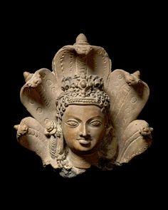 "John Eskenazi LtdHead of Manasa, the serpent goddessEastern IndiaGupta period, early 6th centuryTerracottaHeight : 30cm (11.81"")The above date has been corroborated by Thermoluminescence analysis."
