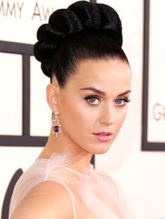The Hottest Hair and Makeup Looks | MOST INTRICATE UPDO | We're not sure what inspired Katy Perry's massive woven hairstyle, but it looks like it could've been challah bread. Either way, we're impressed with the sheer size of the bun-meets-braid combo.