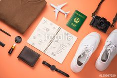 """Download the royalty-free photo """"Summer traveling concept. Vacation accessories on orange background."""" created by makistock at the lowest price on Fotolia.com. Browse our cheap image bank online to find the perfect stock photo for your marketing projects!"""