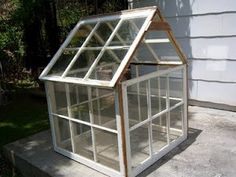 What do you do with your old windows? We replaced our windows in our home, couldn't bare to throw out those beautiful drafty windows. Small Garden Greenhouse, Greenhouse Kitchen, Window Greenhouse, Homemade Greenhouse, Portable Greenhouse, Greenhouse Ideas, Old Wood Windows, Antique Windows, Vintage Windows