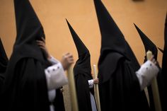Hooded penitents from the Santa Genoveva brotherhood took part in a procession in Seville, Spain, Monday. Hundreds of processions are held throughout Spain during the Easter Holy Week. (Emilio Morenatti/Associated Press)