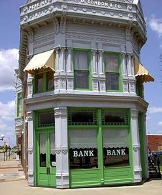 Here's the actual bank in Coffeyville, Kansas where the Dalton Gang tried to rob! ~ a few family members lived here, came by covered wagon~ Iknow this bank.it looked quite different. Aportion of the streets still maintain remain brick and mortar~ Kansas Missouri, Kansas Usa, State Of Kansas, Kansas City, Coffeyville Kansas, Dalton Gang, Great Places, Places To Go, Land Of Oz