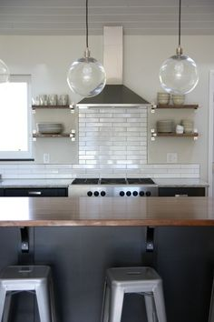 perfect mix of neutral, metal, and light in the kitchen.