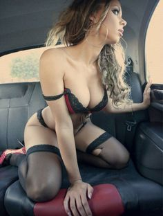 Sexy beauty waiting on the back seat
