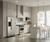 Two tone kitchen with gray cabinets and a white island