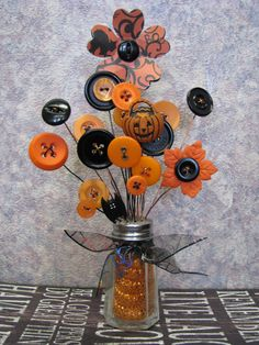 "These are my Halloween series. ~~~~~~~~~~~~~~~~~~~~ I love creating what I call my ""Button-Lee"" Bouquets. They measure anywhere from 2-10 in height. Prices range from $3 to $75. Each one I make, I take great pride in. It takes days to create them. I want them to be beautifully appealing to the eye. They look great anywhere! Your desk. On a bookshelf or mantel. They can make great gifts for young ones and adults alike. Each bouquet is one of a kind since I collect my salt shakers and buttons…"