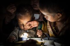 ©Marco Boria Italian photographer,  Two brothers enjoying early morning breakfat in a Nothen Laos Village #faces #reportage #documentary #life #travel #portrait #world #laos