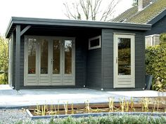 Modern bespoke L shape cabin, painted dark green/grey with white trims.