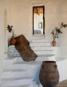 Awesome detail on stairs with re-purposed wood or painted concrete simulating rocks...Mykonos house, Greece