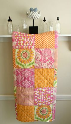 Baby Girl Crib Quilt -  Pop Daisy by Heather Bailey with a Pink and Tangerine mix by Amy Butler. $79.00, via Etsy.