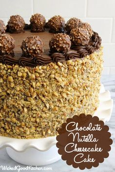 Chocolate Nutella Cheesecake Cake by WickedGoodKitchen.com ~ Chocolate-Hazelnut Velvet Cake with Nutella Cheesecake and Chocolate-Nutella Cream Cheese Buttercream. Irresistible! #dessert #recipe