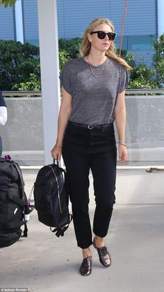 Monochrome cool: Maria Sharapova teamed a dark grey T-shirt, tucked into a pair of ankle s...