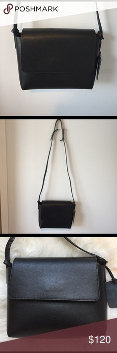 Italian Leather - Cute basic cross body bag Imported from 🇮🇹 Italy! This cross body bag is adorable.  There is a detachable pouch that comes with the bag.  Brand New. Black with black inside.  Make me a reasonable offer.  Smells of leather and is made with the best, durable Italian leather. Bags Crossbody Bags
