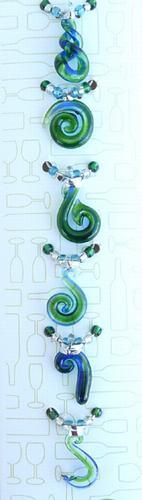 These lovely New Zealand Maori Wine Charms are individually handcrafted from glass. The pack of 6 glass wine charms includes Koru, Twist and Hook designs. Maori Designs, Wine Charms, Wedding Favours, Kiwi, Wine Glass, Party Ideas, Charmed, Decorations, Christmas Ornaments