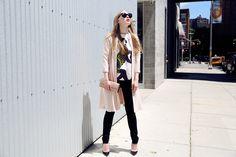 Carolina Engman Black skinny trouser, printed t-shirt and baige long jacket (coat?)