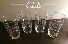 Cleveland Glass Gift Set - 4 Etched Tall Drinking Glasses Cleveland - Buckeyes - Cleveland Gift. Our Gift Set of Cleveland Themed Etchings include 4 Glasses: -CLE -216 -State of Ohio with Home & Heart over Cleveland -O-H-I-O Silhouette. Please do not hesitate to message us your own combination. Thanks!.
