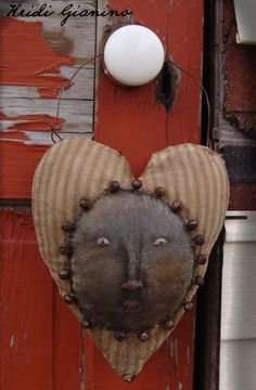 Prim Hanging Heart With Face Encircled in Rusty Bells...This is a very unique heart...there isn't another one like it!
