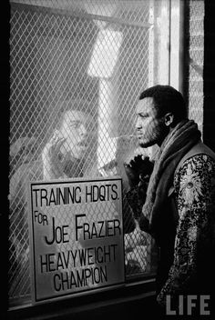 Muhammad Ali taunting Joe Frazier during training for their fight.1971