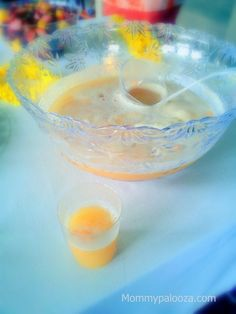 Tropical fruit punch for your graduation party!  1 - 2 liter bottle of ginger ale  1 can of frozen lemonade {thawed}  6 cups chilled Dole brand Pineapple-Orange juice {or can substitute just pineapple or just orange juice}  2 heaping scoops of pineapple sherbet  2 heaping scoops of orange sherbet