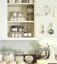 Use Command(TM) Hooks by 3M inside your cabinets to hang baking utensils.