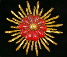 Roaring 20's Art Deco brass & red celluloid sunburst brooch, fabulous cellulose acetate flower on bright brass rays starburst statement pin by BetseysBeauties on Etsy