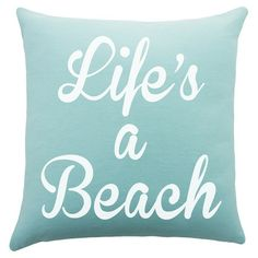 Bring beach-chic style to your sofa or favorite reading nook with this charming cotton pillow, featuring a typographic motif. Handmade in the USA.