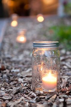Mason jar candles are the perfect accent to your wedding decor! {Ashley Bartoletti Photography}
