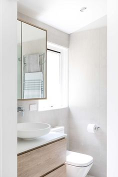 A calming ensuite can come in any size. The soft curves of the above counter basin counteract the angles of the mirror cabinet and vanity, bringing organic shape that promotes the feel of a day spa in the bathroom. Beige Bathroom, Laundry In Bathroom, Bathroom Inspo, Bathroom Ideas, Bathroom Interior Design, Interior Design Living Room, Interior Decorating, Farmhouse Renovation, Mirror Cabinets