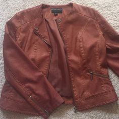 Leather jacket Brown leather jacket new w/o tags. This was a gift and it was too big. Never worn. Still has the tag attachment piece. Bernardo Jackets & Coats