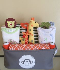 Giraffe and Pals Includes: 3 soft cotton Carters's receiving blankets, 1 Jungle Giraffe theme large plush blanket, giraffe footed pajamas (size months), 1 giraffe and pals themed onesie (size Baby Boy Gift Baskets, Birthday Gift Baskets, Baby Boy Gifts, Gifts For Boys, Baby Shower Favors, Baby Shower Gifts, Baby Shower Planner, Theme Baskets, Baby First Halloween
