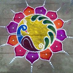 Here is the 15 best Colourful Rangoli Designs and Patterns that can add the colour to your festive decorations. Rangoli Designs Peacock, Simple Rangoli Border Designs, Rangoli Simple, Indian Rangoli Designs, Rangoli Designs Latest, Free Hand Rangoli Design, Small Rangoli Design, Colorful Rangoli Designs, Rangoli Ideas