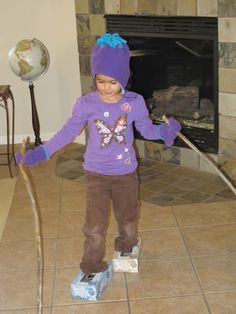 Indoor Winter Obstacle Course ideas (Including this fun pretend skiing idea using empty tissue boxes as skis and long sticks as poles.)