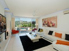 Ultra modern living room with design furniture at this 5 bedroom front line golf villa for sale, Los Naranjos Golf, Listing ID 1196, Nueva Andalucía, Marbella, Costa del Sol, Spain.