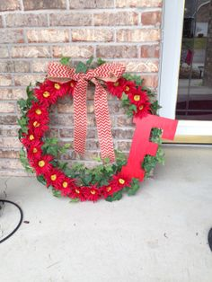 Wreath for my sister.  Painted letter, glue gun and any flowers you like - easy!