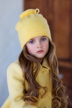 Love the color contrasts of her blue eyes and the yellow!