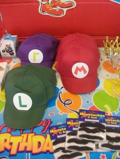 I made hats for the boys with ball caps I found at the dollar store. With paper letters I made Mario, Luigi & Wario hats. I found the mustaches on Amazon. The boys didn't leave them on long as they were itchy!