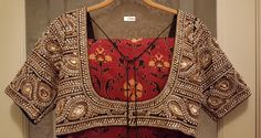 Ajrakh silk saree (by Tanishq) from Gujarat (India) with a stone embroidery contrast color blouse. This is block print on textile. The colors of the saree are made from natural dyes. According to legends, the descendants of Lava and Kusha ( sons of Lord Rama and his wife Seetha ) were the first Ajrakh printers. Titan (from Tata) has just launched a saree collection under the brand name Tanishq.