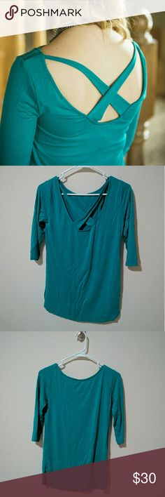 Teal 3/4 sleeve rayon cross back top Super soft teal rayon top with cross back detail. The cross back detail is just a little sexy but you can still wear a bra with it, no problem!  It's a little wrinkly from being in storage for awhile but nothing a quick steam won't fix!  Worn maybe twice Loveappella Tops Tees - Long Sleeve